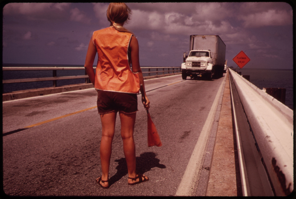 Female Road Worker Directs Traffic During Repairs on the Overseas Highway Leading to Key West by Flip Schulke